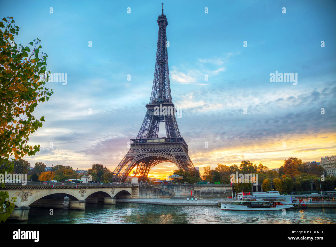 Cityscape with the Eiffel tower in Paris, France at sunrise - Stock Image