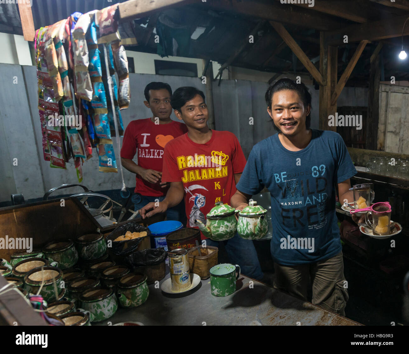 Native waiter offering tea from booth, Food Market, Yogyakarta, Java, Indonesia - Stock Image
