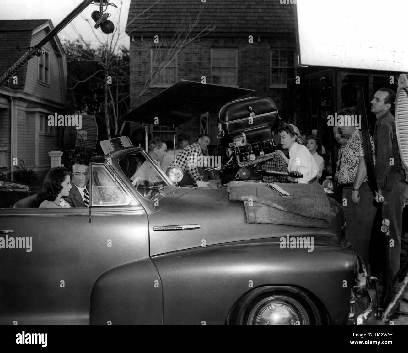 OUTRAGE, Mala Powers and Robert Clarke on set as director Ida Lupino checks camera angle, 1950 Stock Photo