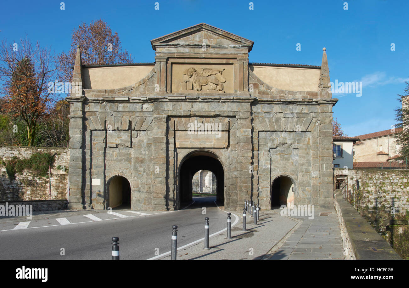 Bergamo, Italy. Gate to the Citta Alta, seen from Viale Vittorio Emmanuele. Obelisks on the corners, and plaque - Stock Image