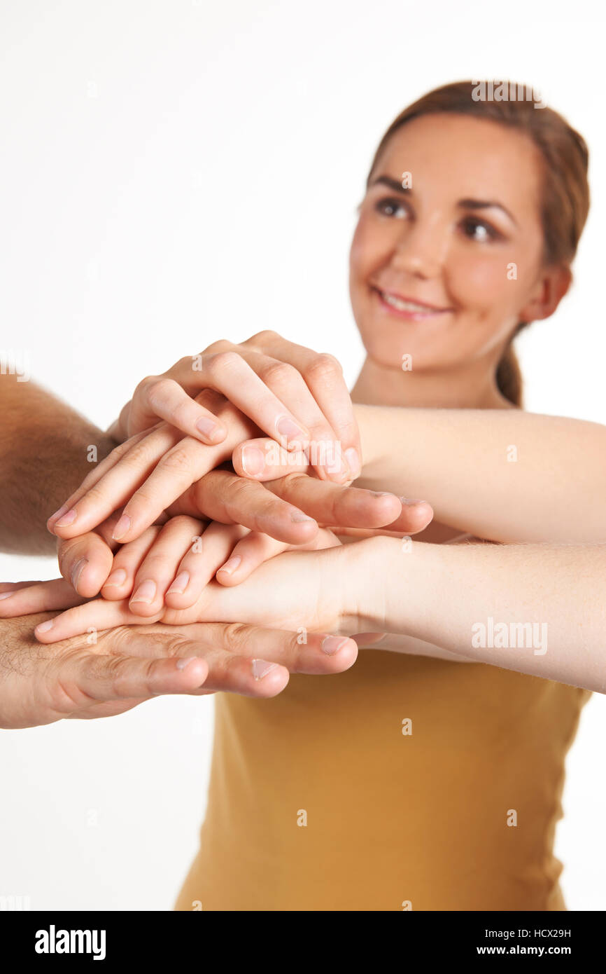 Group Of Young Friends Joining Hands Together - Stock Image