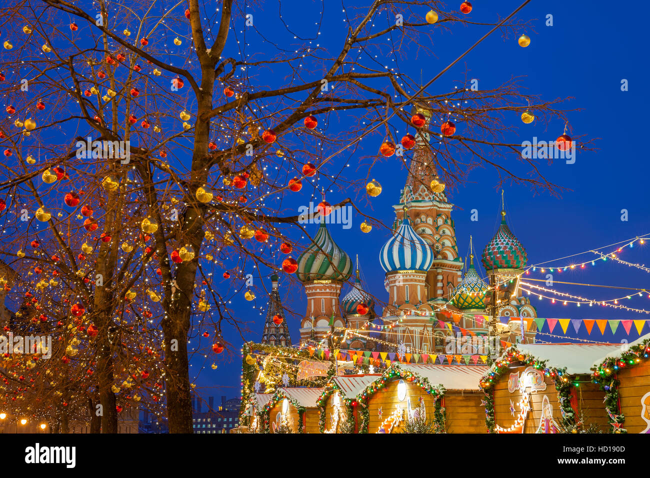 Christmas decorations at the Red Square with St. Basils Cathedral on the background, Moscow, Russia - Stock Image