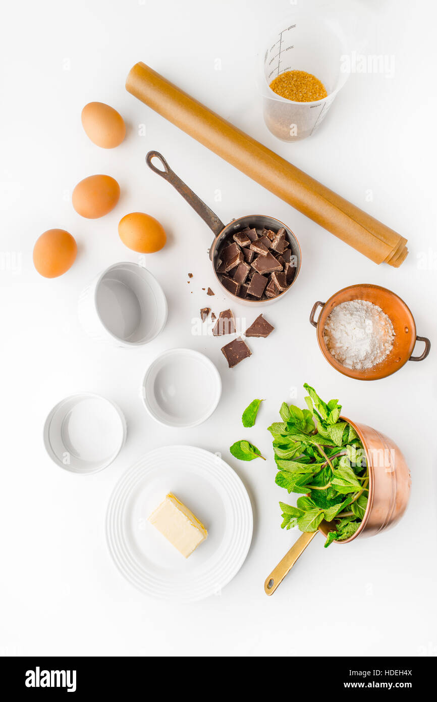 egg chocolate sugar butter flour mint herb leaf - Stock Image