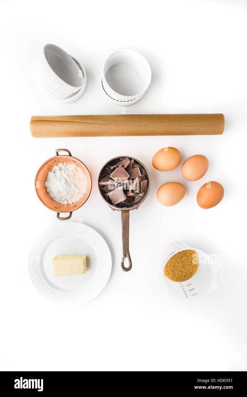 Ingredient for chocolate fondant on the white background vertical - Stock Image
