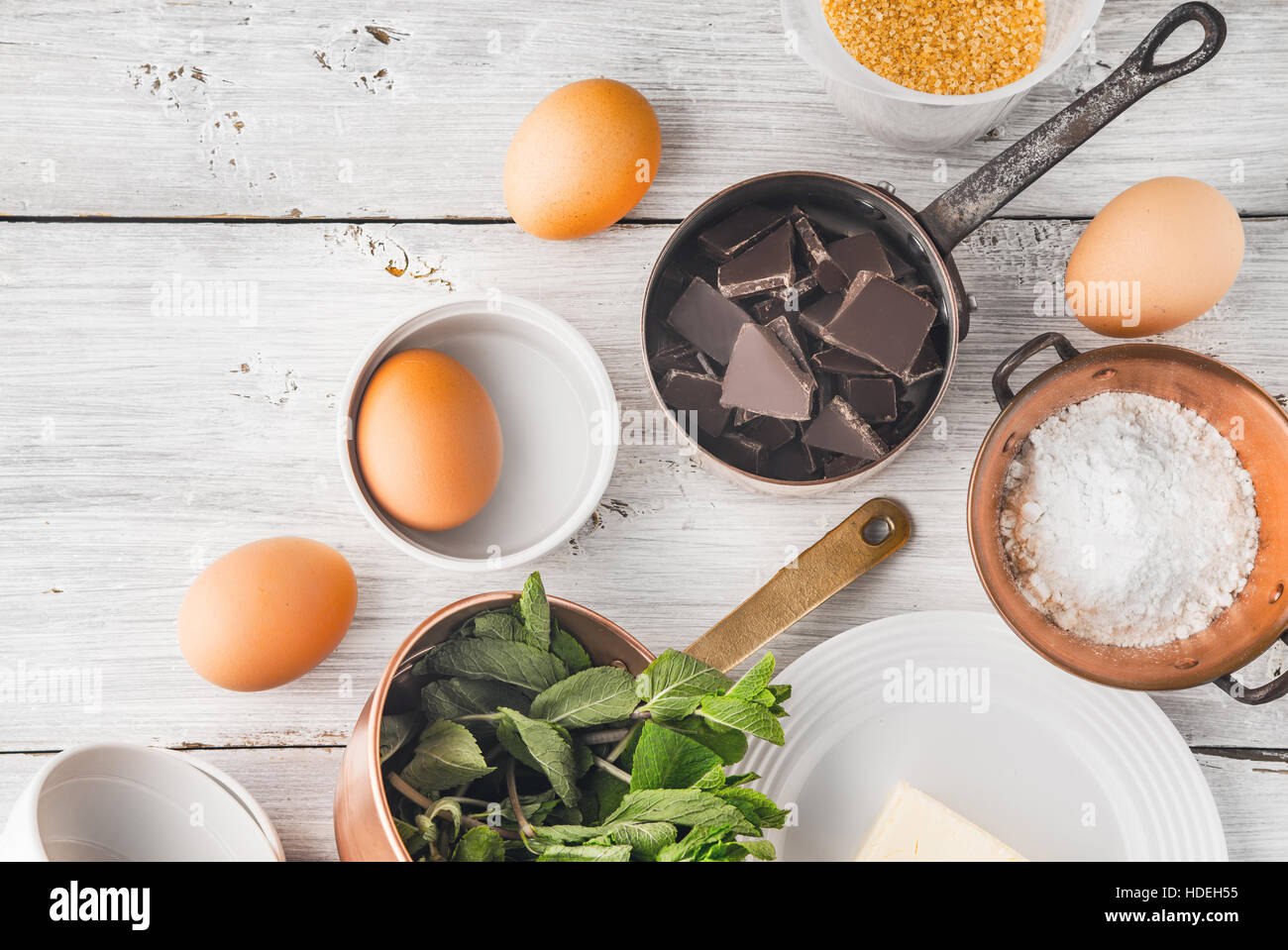 Ingredient for chocolate fondant on the white table top view - Stock Image