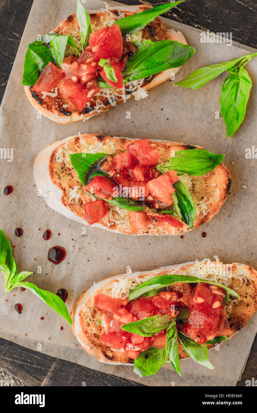 tomato basil bread seasoning vegetable board food - Stock Image