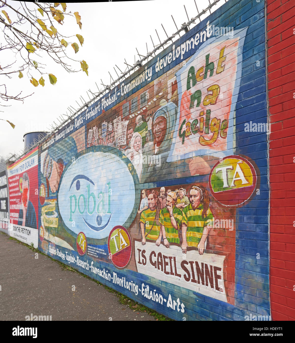 International Peace Wall,Cupar Way,West Belfast,Northern Ireland,UK,International,Peace,Wall,Cupar,Belfast,arts,development,Is gaeil sinne,is,gaeil,sinne,mural,GoTonySmith,@HotpixUK,Tony,Smith,UK,GB,Great,Britain,United,Kingdom,Irish,British,Ireland,problem,with,problem with,issue with,NI,Northern,Northern Ireland,Belfast,City,Centre,Art,Artists,the,troubles,The Troubles,Good Friday Agreement,Peace,honour,painting,wall,walls,tribute,republicanism,Fight,Justice,West,Beal,feirste,martyrs,social,tour,tourism,tourists,urban,six,counties,6,backdrop,county,Antrim,Buy Pictures of,Buy Images Of,Images of,Stock Images,Tony Smith,United Kingdom,Great Britain,British Isles