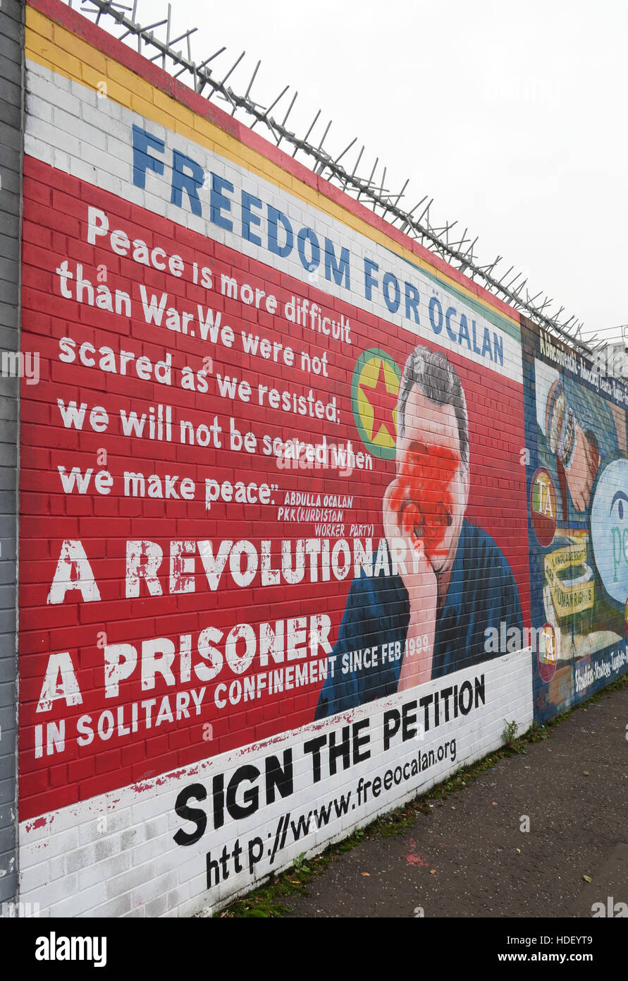 International Peace Wall,Cupar Way,West Belfast,Northern Ireland,UK,International,Peace,Wall,Cupar,Freedom,For,Ocalan,petition,prisoner,revolutionary,Öcalan,PKK,Turkish-born,PKK,Kurdistan Workers Party,founder,Abdullah Öcalan,Abdullah,Öcalan,mural,Peace Is More Difficult Than war,GoTonySmith,@HotpixUK,Tony,Smith,UK,GB,Great,Britain,United,Kingdom,Irish,British,Ireland,problem,with,problem with,issue with,NI,Northern,Northern Ireland,Belfast,City,Centre,Art,Artists,the,troubles,The Troubles,Good Friday Agreement,Peace,honour,painting,wall,walls,tribute,republicanism,Fight,Justice,West,Beal,feirste,martyrs,social,tour,tourism,tourists,urban,six,counties,6,backdrop,county,Antrim,Buy Pictures of,Buy Images Of,Images of,Stock Images,Tony Smith,United Kingdom,Great Britain,British Isles