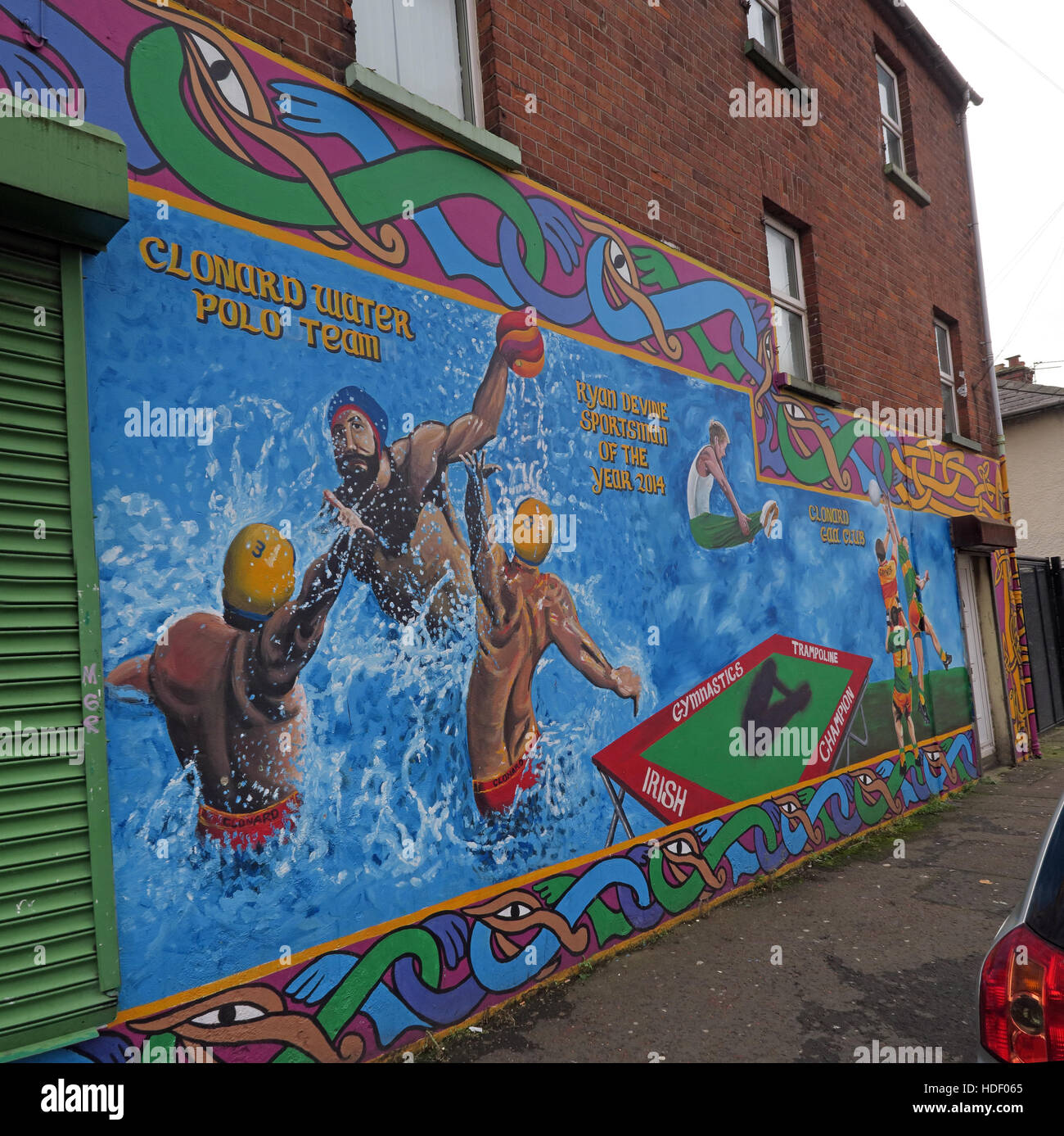 Road,painting,graffiti,resistance,IRA,peace,Northern Ireland,NI,UK,St,street,Eire,Irish,Republic,Irish Republic,conflict,Irish Republican Army,Political Change,gable,end,gable end,Irish,Sport,Clonard Water Polo Team,Clonard,Water Polo,Team,GoTonySmith,@HotpixUK,Tony,Smith,UK,GB,Great,Britain,United,Kingdom,Irish,British,Ireland,problem,with,problem with,issue with,NI,Northern,Northern Ireland,Belfast,City,Centre,Art,Artists,the,troubles,The Troubles,Good Friday Agreement,Peace,honour,painting,wall,walls,tribute,republicanism,Fight,Justice,West,Beal,feirste,martyrs,social,tour,tourism,tourists,urban,six,counties,6,backdrop,county,Antrim,occupation,good,Friday,agreement,peace,reconciliation,IRA,terror,terrorists,genocide,Belfast streets,catholic,community,catholics,Buy Pictures of,Buy Images Of,Images of,Stock Images,Tony Smith,United Kingdom,Great Britain,British Isles,republican cause,Belfast Catholic Community