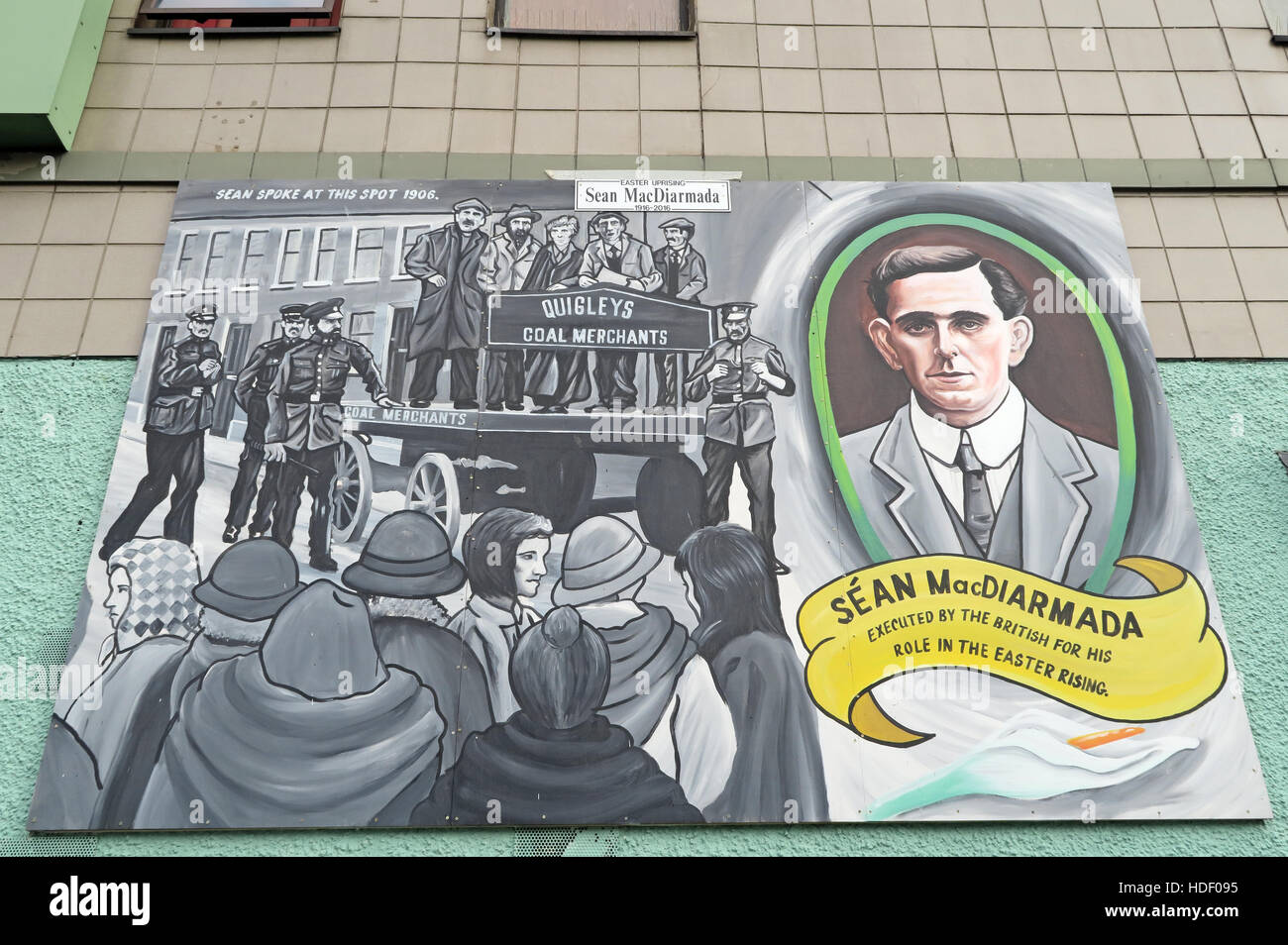 Road,painting,graffiti,resistance,IRA,peace,Northern Ireland,NI,UK,St,street,Eire,Irish,Republic,Irish Republic,conflict,Irish Republican Army,Political Change,Sean MacDiarmada,Sean,MacDiarmada,executed,by the,British,for,Easter Rising,Quigleys,coal,merchants,merchant,GoTonySmith,@HotpixUK,Tony,Smith,UK,GB,Great,Britain,United,Kingdom,Irish,British,Ireland,problem,with,problem with,issue with,NI,Northern,Northern Ireland,Belfast,City,Centre,Art,Artists,the,troubles,The Troubles,Good Friday Agreement,Peace,honour,painting,wall,walls,tribute,republicanism,Fight,Justice,West,Beal,feirste,martyrs,social,tour,tourism,tourists,urban,six,counties,6,backdrop,county,Antrim,occupation,good,Friday,agreement,peace,reconciliation,IRA,terror,terrorists,genocide,catholic,community,catholics,Buy Pictures of,Buy Images Of,Images of,Stock Images,Tony Smith,United Kingdom,Great Britain,British Isles,republican cause,Belfast Catholic Community