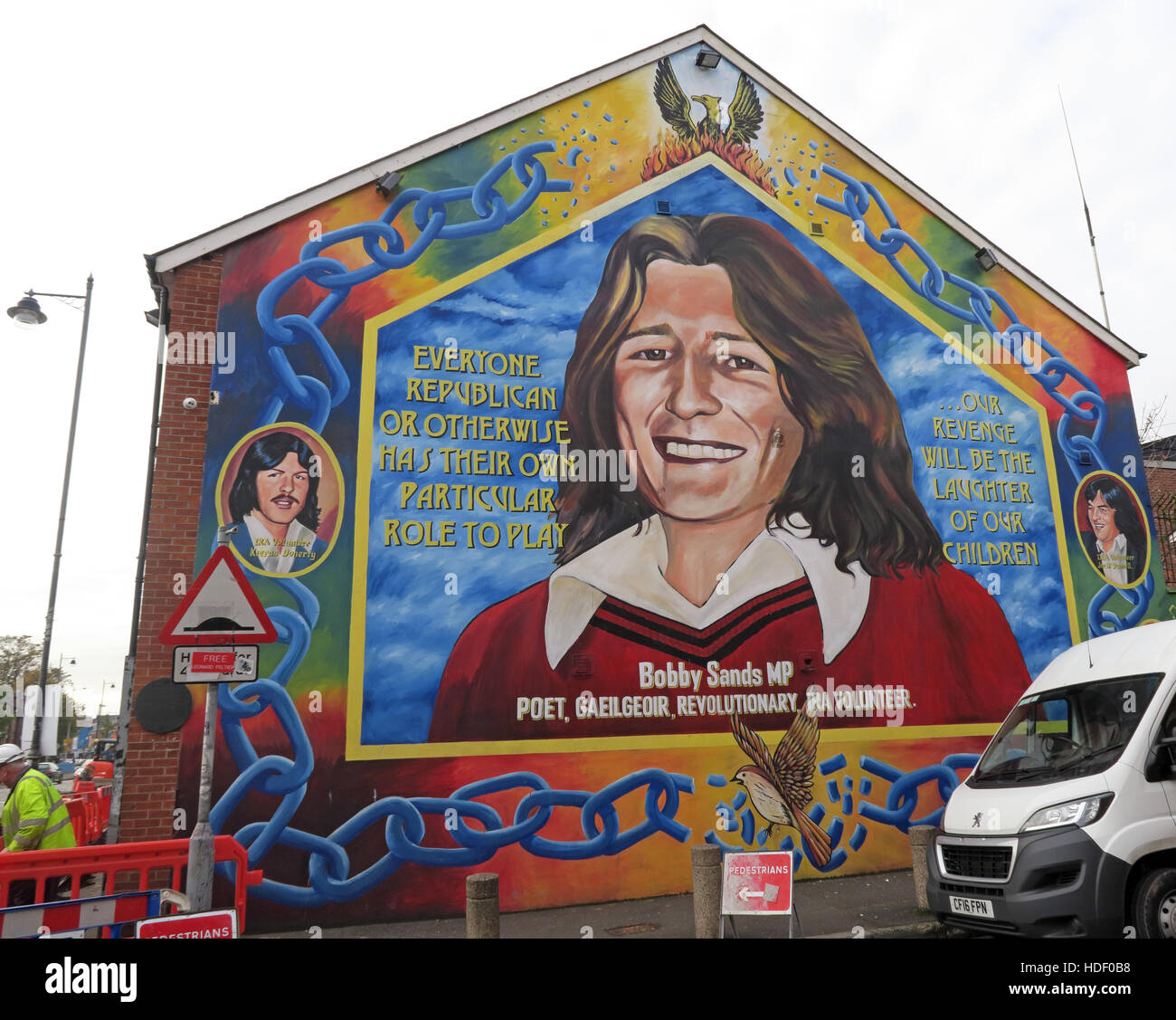 Road,painting,graffiti,resistance,IRA,peace,Northern Ireland,NI,UK,St,street,Eire,Irish,Republic,Irish Republic,conflict,Irish Republican Army,Political Change,MP,Bobby Sands,hero,martyr,soldier,terrorist,hunger striker,hunger,striker,GoTonySmith,@HotpixUK,Tony,Smith,UK,GB,Great,Britain,United,Kingdom,Irish,British,Ireland,problem,with,problem with,issue with,NI,Northern,Northern Ireland,Belfast,City,Centre,Art,Artists,the,troubles,The Troubles,Good Friday Agreement,Peace,honour,painting,wall,walls,tribute,republicanism,Fight,Justice,West,Beal,feirste,martyrs,social,tour,tourism,tourists,urban,six,counties,6,backdrop,county,Antrim,occupation,good,Friday,agreement,peace,reconciliation,IRA,terror,terrorists,genocide,Buy Pictures of,Buy Images Of,Images of,Stock Images,Tony Smith,United Kingdom,Great Britain,British Isles,republican cause