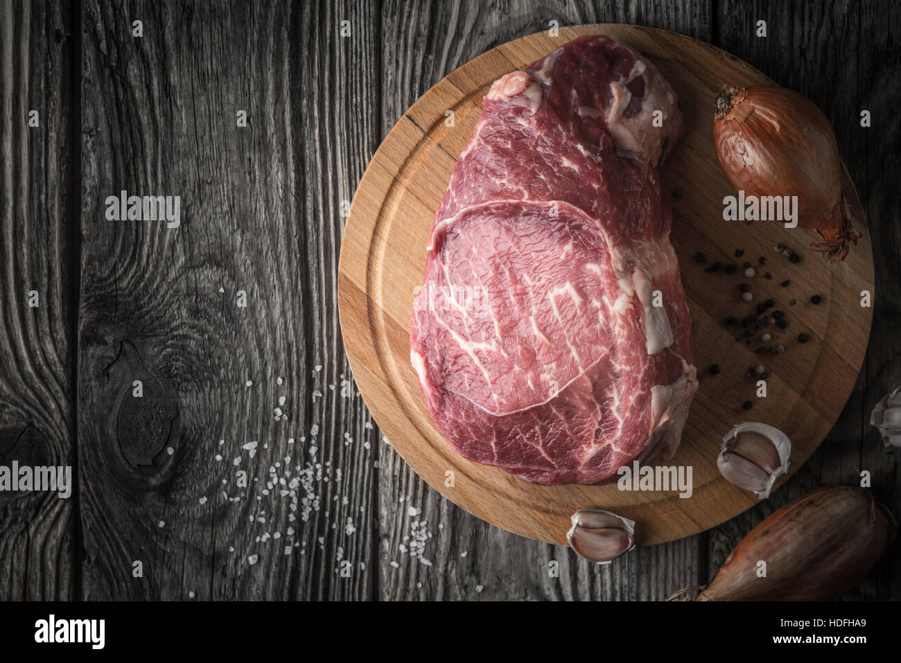Raw angus beef  with seasoning on the wooden table top view - Stock Image