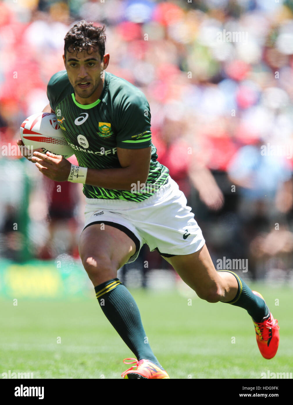The SA Rugby Springbok Sevens players in action during the 2016 HSBC Sevens tournament at the Cape Town Stadium - Stock Image