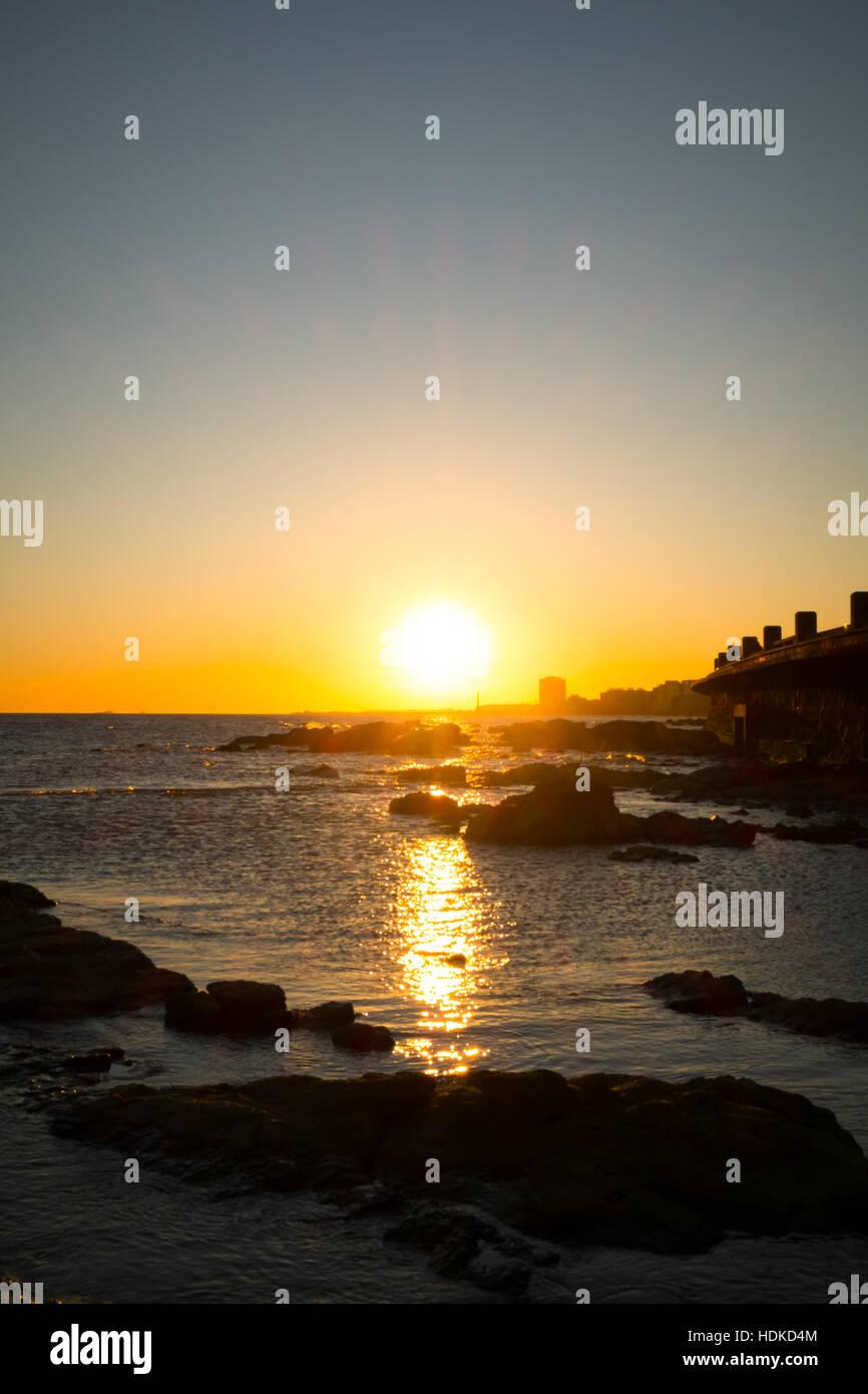 Montevideo at sunset on the Rio de la Plata - Stock Image