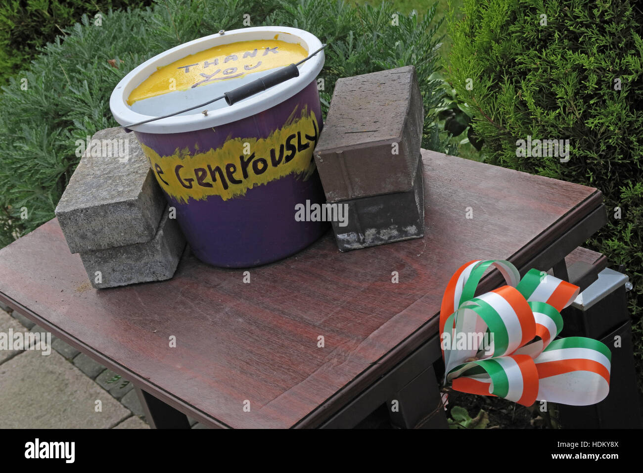Donation,donations,bucket,for,Falls road,West Belfast,Belfast,West,Northern Ireland,UK,Iris,Community,Republican,Republicans,fund,funding,IRA,Sinn Fein,ribbon,flag,flags,tricolor,tricolour,tin for donations,Irish Flag,GoTonySmith,@HotpixUK,Tony,Smith,UK,GB,Great,Britain,United,Kingdom,Irish,British,Ireland,problem,with,problem with,issue with,NI,Northern,Northern Ireland,Belfast,City,Centre,Art,Artists,the,troubles,The Troubles,Good Friday Agreement,Peace,honour,painting,wall,walls,tribute,republicanism,Fight,Justice,West,Beal,feirste,martyrs,social,tour,tourism,tourists,urban,six,counties,6,backdrop,county,Antrim,national flag of Ireland,national,flag,of,Ireland,Irish tricolour,ensign,green,white,orange,Buy Pictures of,Buy Images Of,Images of,Stock Images,Tony Smith,United Kingdom,Great Britain,British Isles