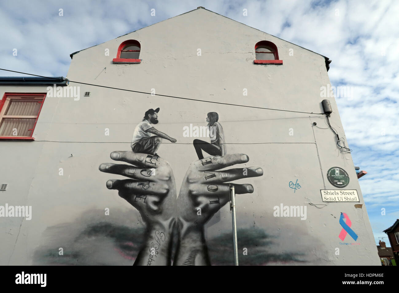 Road,painting,graffiti,resistance,IRA,peace,Northern Ireland,NI,UK,St,street,Eire,Irish,Republic,Irish Republic,conflict,Irish Republican Army,Political Change,arms,arm,couple,people,street,hand,hands,St,hands,gable end,Shiels Street,Shiels St,GoTonySmith,@HotpixUK,Tony,Smith,UK,GB,Great,Britain,United,Kingdom,Irish,British,Ireland,problem,with,problem with,issue with,NI,Northern,Northern Ireland,Belfast,City,Centre,Art,Artists,the,troubles,The Troubles,Good Friday Agreement,Peace,honour,painting,wall,walls,tribute,republicanism,Fight,Justice,West,Beal,feirste,martyrs,social,tour,tourism,tourists,urban,six,counties,6,backdrop,county,Antrim,occupation,good,Friday,agreement,peace,reconciliation,IRA,terror,terrorists,genocide,Belfast streets,catholic,community,catholics,Buy Pictures of,Buy Images Of,Images of,Stock Images,Tony Smith,United Kingdom,Great Britain,British Isles,republican cause,Belfast Catholic Community