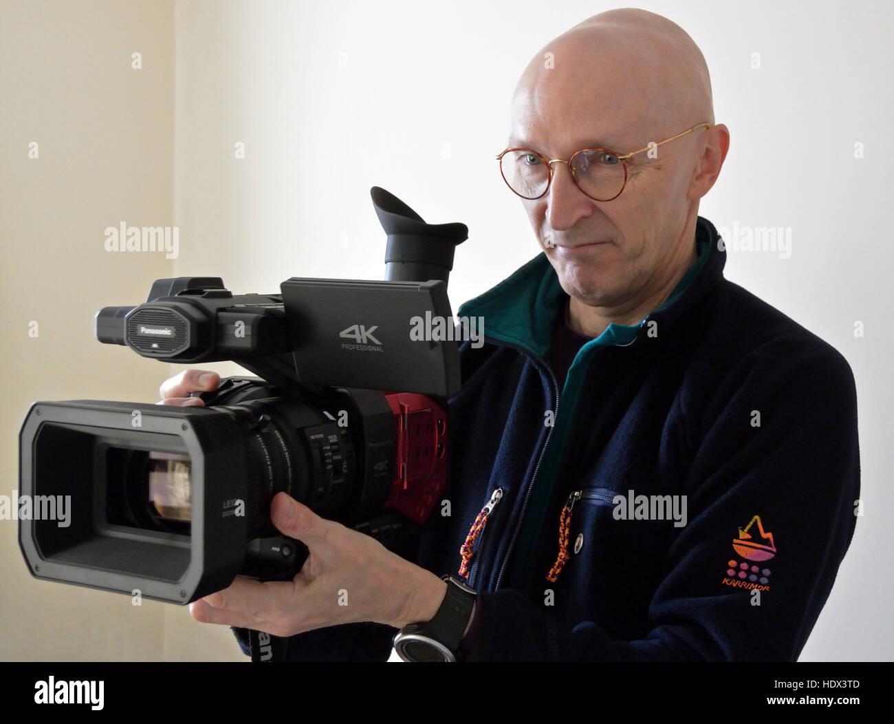 Clive Tully FRGS holding Panasonic AG-DVX200 professional video camera Stock Photo