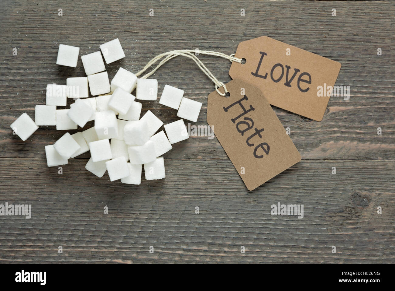 Love versus hate for sugar - Stock Image