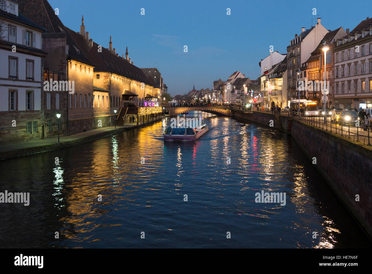 A tourist boat on the L'Ill river at night, Strasbourg Stock Photo