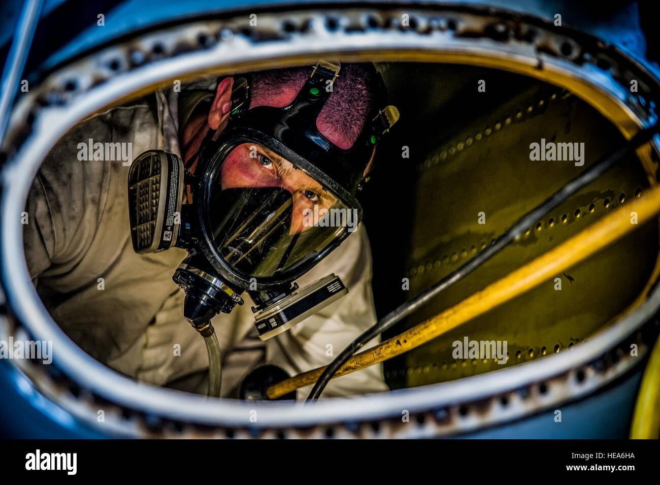 Airman 1st Class Nicholas McKinney prepares to be extracted from the inside of a C-17 Globemaster III fuel tank - Stock Image