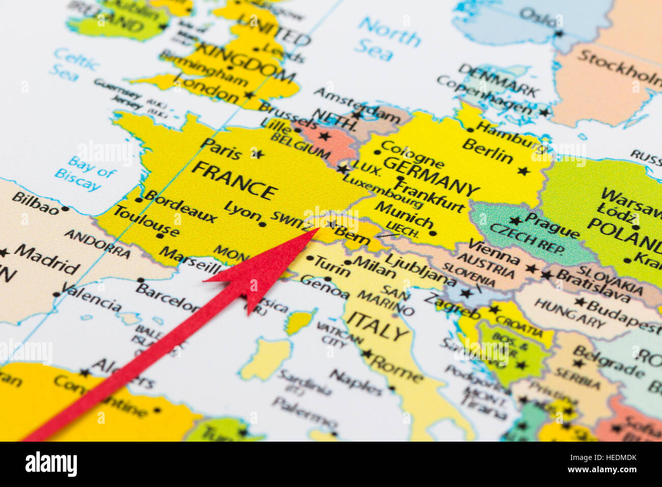 Red arrow pointing Switzerland on the map of Europe continent Stock