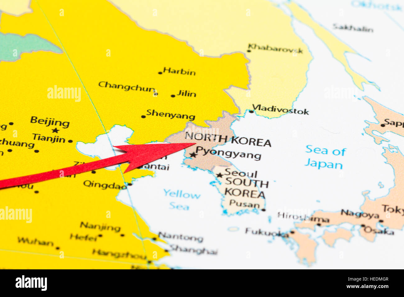 Red arrow pointing North Korea on the map of Asia continent Stock