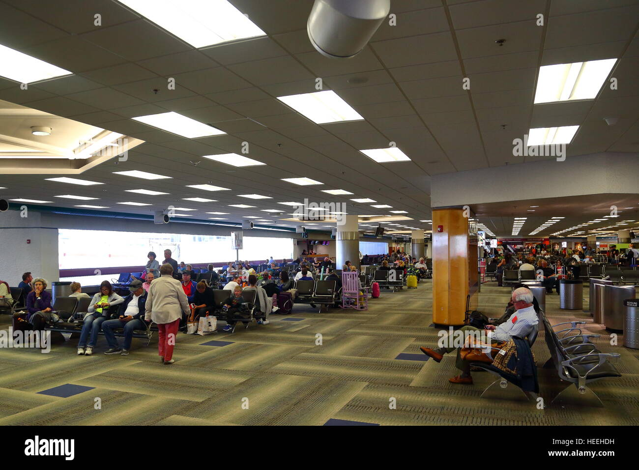 passengers waiting for their flights inside the terminal
