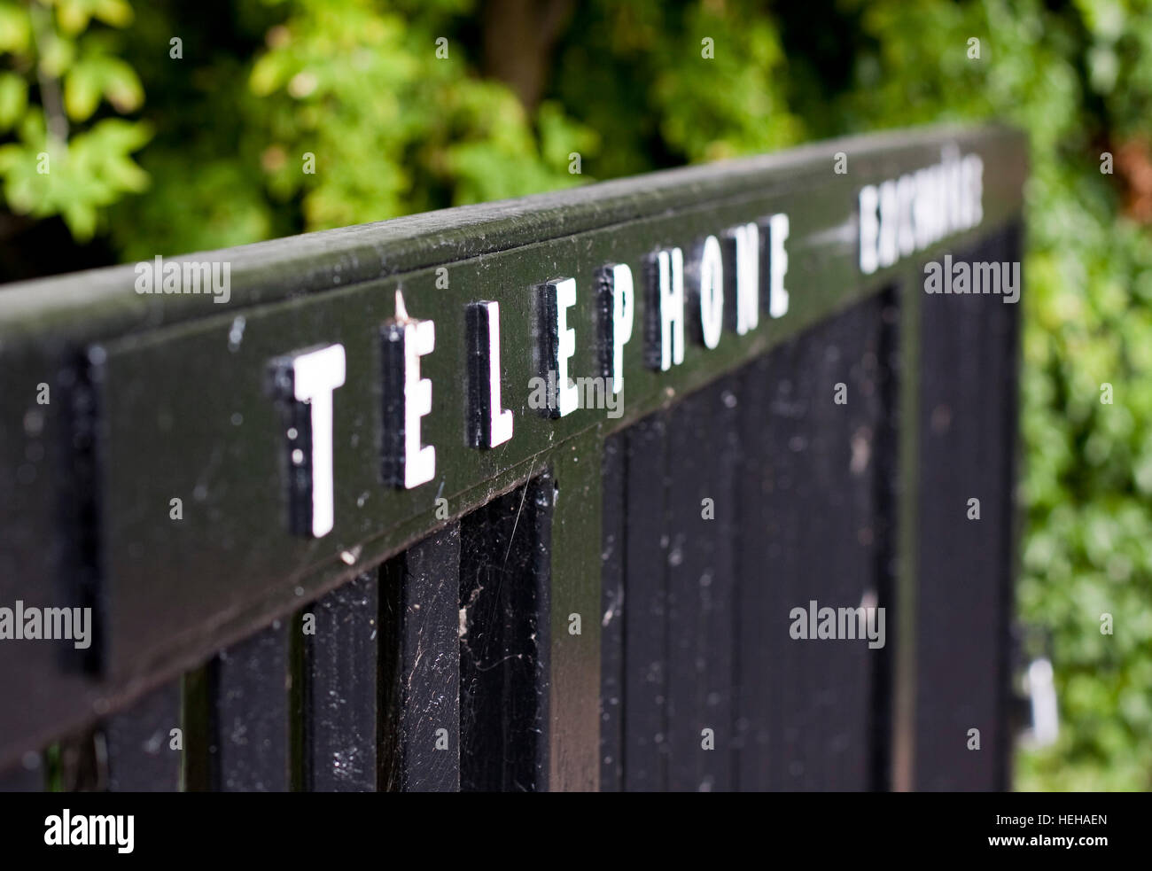 Raised letters spelling Telephone Exchange on a gate Stock Photo