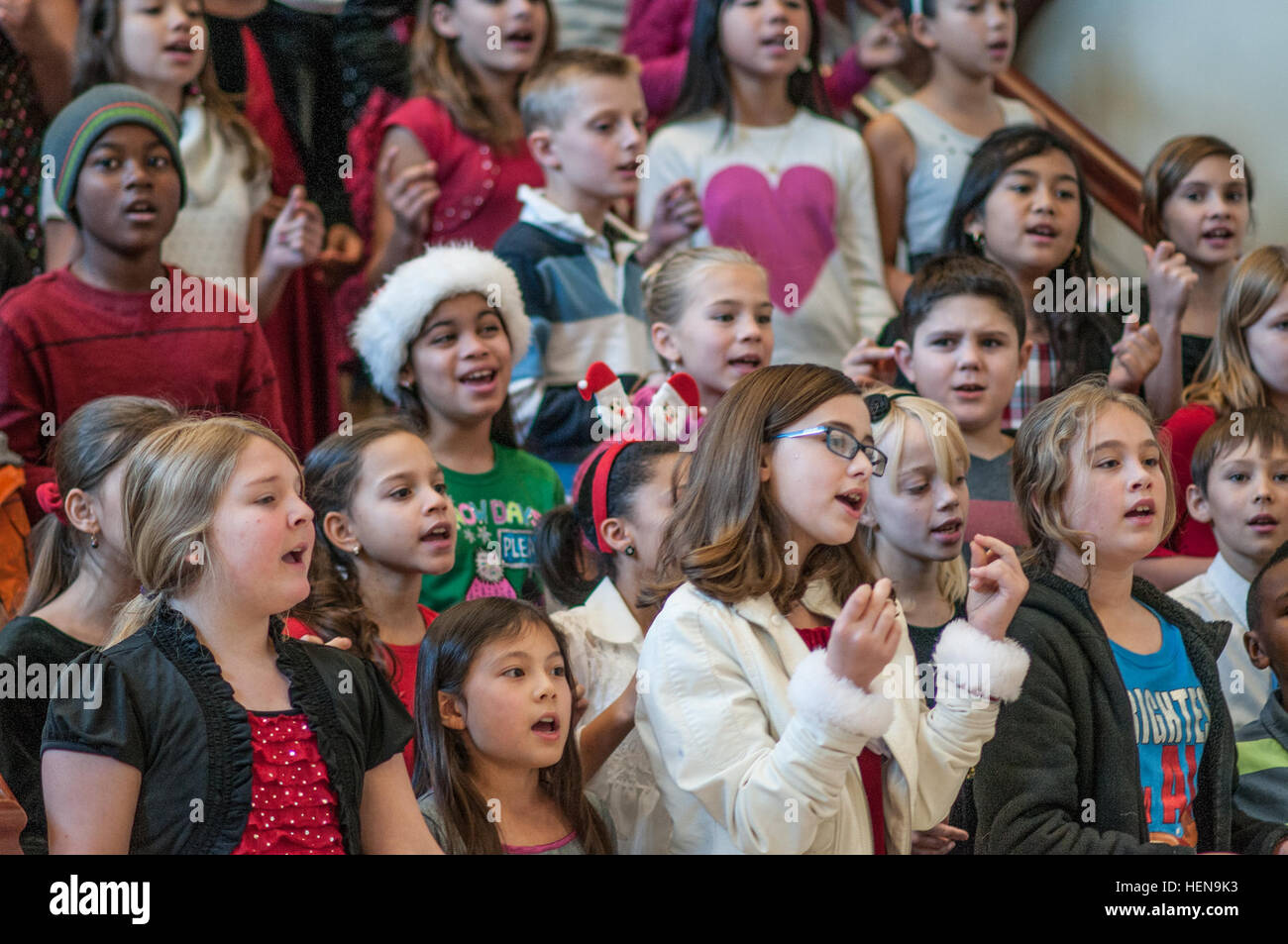 Children from Old Bowley School sing Christmas songs during the U.S ...