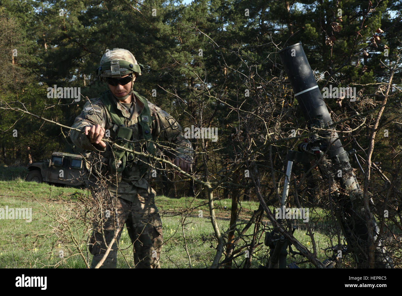 A US Soldier Of 1st Squadron 91st Cavalry Regiment 173rd Airborne Brigade Camouflage M120 Mortar System While Conducting Defensive Operations During