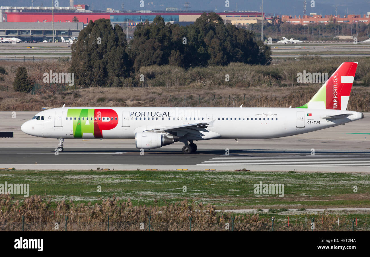TAP Portugal Airbus A321 taxiing along the runway at El Prat Airport in Barcelona, Spain. - Stock Image