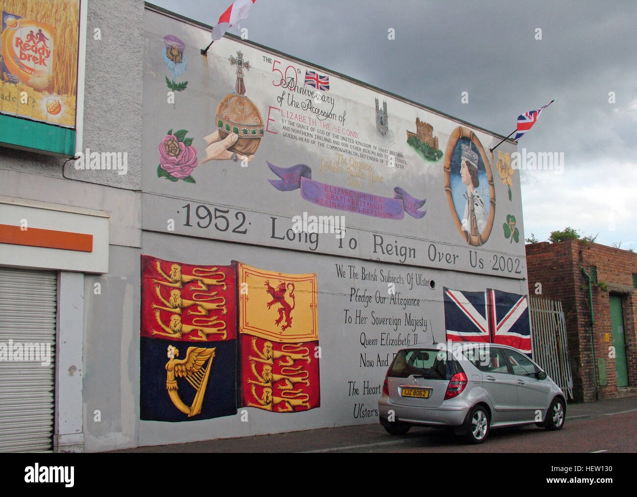 Unionist,British,Shankil,rd,painting,art,artist,martyr,fighter,para,paramilitary,soldier,wall,gable,end,gable end,community,protestant,Shankill Road Mural,West,West Belfast,NI,Northern Ireland,1952,Queen,Long To Rein Over Us,union,flag,union flag,harp,crest,British Crest,car,GoTonySmith,@HotpixUK,Tony,Smith,UK,GB,Great,Britain,United,Kingdom,Irish,British,Ireland,problem,with,problem with,issue with,NI,Northern,Northern Ireland,Belfast,City,Centre,Art,Artists,the,troubles,The Troubles,Good Friday Agreement,Peace,honour,painting,wall,walls,tribute,unionism,Fight,Justice,West,Beal,feirste,martyrs,social,tour,tourism,tourists,urban,six,counties,6,backdrop,county,Antrim,DUP,democratic Unionist,red hand,of Ulster,Red Hand Of Ulster,Shankill,Rd,road,Shankill Road,streets of Belfast,protestant,religion,intolerance,prejudice,Buy Pictures of,Buy Images Of,Images of,Stock Images,Tony Smith,United Kingdom,Great Britain,British Isles