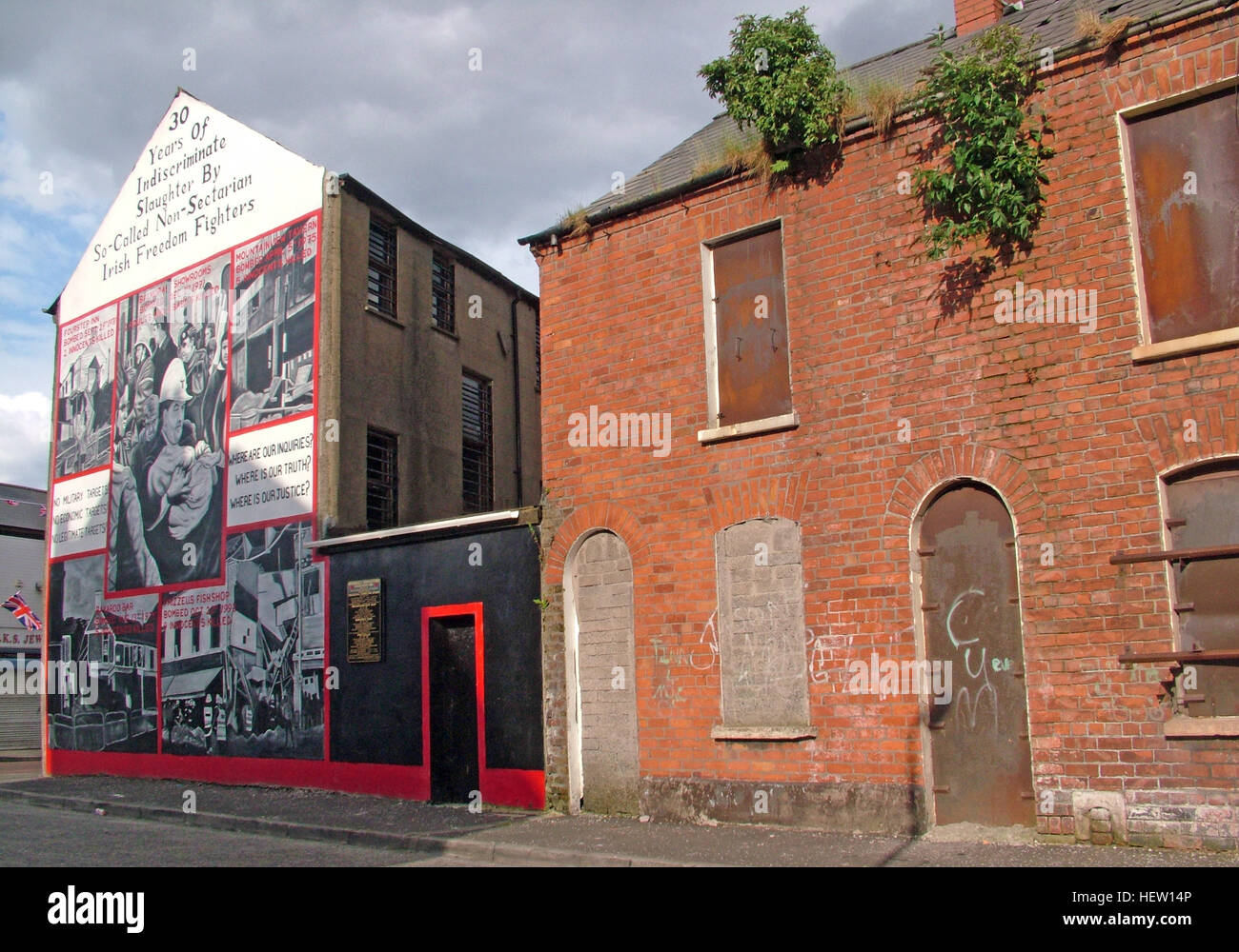 Unionist,British,Shankil,rd,painting,art,artist,martyr,fighter,para,paramilitary,soldier,wall,gable,end,gable end,community,protestant,Shankill Road Mural,West,West Belfast,NI,Northern Ireland,thirty,years,of,slaughter,30,30 years of slaughter,terrace,terraced,house,houses,GoTonySmith,@HotpixUK,Tony,Smith,UK,GB,Great,Britain,United,Kingdom,Irish,British,Ireland,problem,with,problem with,issue with,NI,Northern,Northern Ireland,Belfast,City,Centre,Art,Artists,the,troubles,The Troubles,Good Friday Agreement,Peace,honour,painting,wall,walls,tribute,unionism,Fight,Justice,West,Beal,feirste,martyrs,social,tour,tourism,tourists,urban,six,counties,6,backdrop,county,Antrim,DUP,democratic Unionist,red hand,of Ulster,Red Hand Of Ulster,Shankill,Rd,road,Shankill Road,streets of Belfast,protestant,religion,intolerance,prejudice,Buy Pictures of,Buy Images Of,Images of,Stock Images,Tony Smith,United Kingdom,Great Britain,British Isles