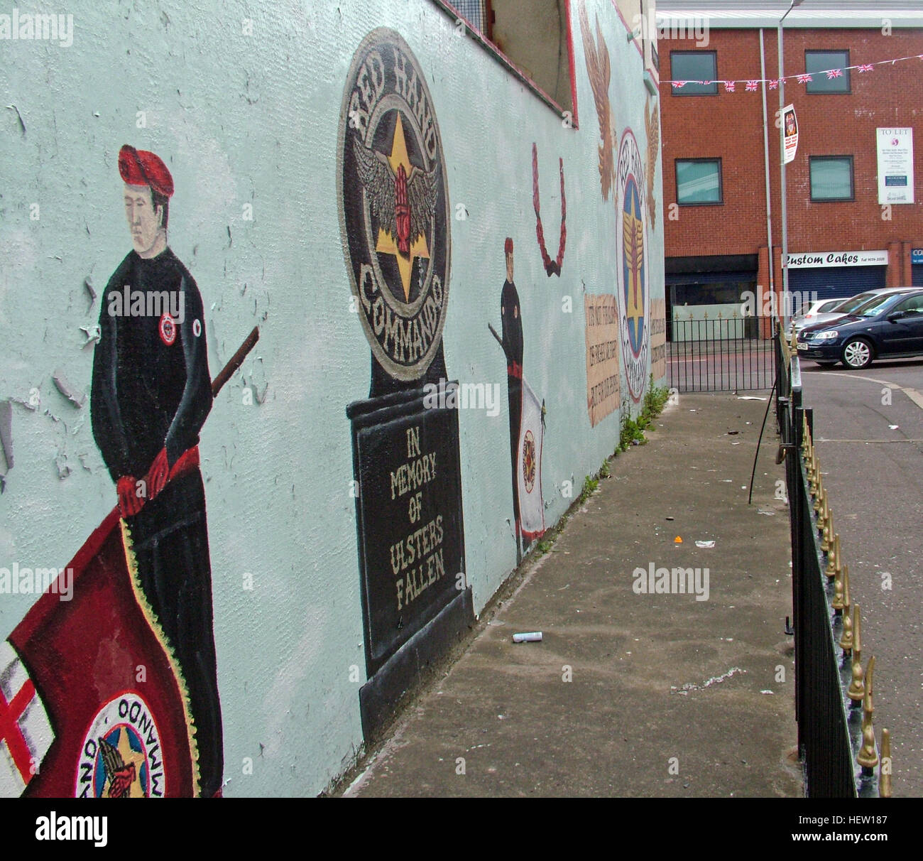 Unionist,British,Shankil,rd,painting,art,artist,martyr,fighter,para,paramilitary,soldier,wall,gable,end,gable end,community,protestant,Shankill Road Mural,West,West Belfast,NI,Northern Ireland,Soldier & Flag,Soldier and Flag,Red Hand Commando,soldier,flag,St George,St Georges,Saint Georges,fence,GoTonySmith,@HotpixUK,Tony,Smith,UK,GB,Great,Britain,United,Kingdom,Irish,British,Ireland,problem,with,problem with,issue with,NI,Northern,Northern Ireland,Belfast,City,Centre,Art,Artists,the,troubles,The Troubles,Good Friday Agreement,Peace,honour,painting,wall,walls,tribute,unionism,Fight,Justice,West,Beal,feirste,martyrs,social,tour,tourism,tourists,urban,six,counties,6,backdrop,county,Antrim,DUP,democratic Unionist,red hand,of Ulster,Red Hand Of Ulster,Shankill,Rd,road,Shankill Road,rail,railing,railings,Buy Pictures of,Buy Images Of,Images of,Stock Images,Tony Smith,United Kingdom,Great Britain,British Isles