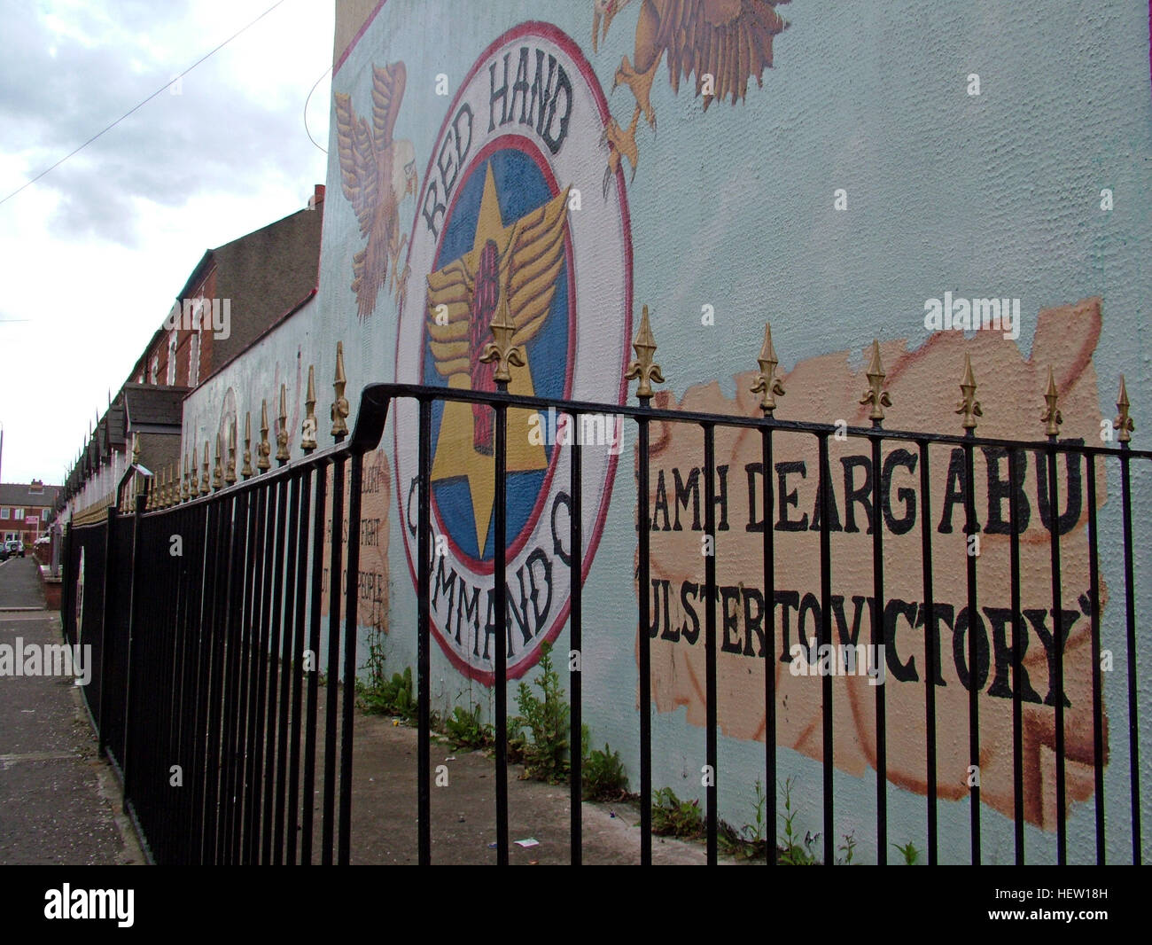 Unionist,British,Shankil,rd,painting,art,artist,martyr,fighter,para,paramilitary,soldier,wall,gable,end,gable end,community,protestant,Shankill Road Mural,West,West Belfast,NI,Northern Ireland,Red Hand Commando,rail,railings,gableend,GoTonySmith,@HotpixUK,Tony,Smith,UK,GB,Great,Britain,United,Kingdom,Irish,British,Ireland,problem,with,problem with,issue with,NI,Northern,Northern Ireland,Belfast,City,Centre,Art,Artists,the,troubles,The Troubles,Good Friday Agreement,Peace,honour,painting,wall,walls,tribute,unionism,Fight,Justice,West,Beal,feirste,martyrs,social,tour,tourism,tourists,urban,six,counties,6,backdrop,county,Antrim,DUP,democratic Unionist,red hand,of Ulster,Red Hand Of Ulster,Shankill,Rd,road,Shankill Road,Buy Pictures of,Buy Images Of,Images of,Stock Images,Tony Smith,United Kingdom,Great Britain,British Isles