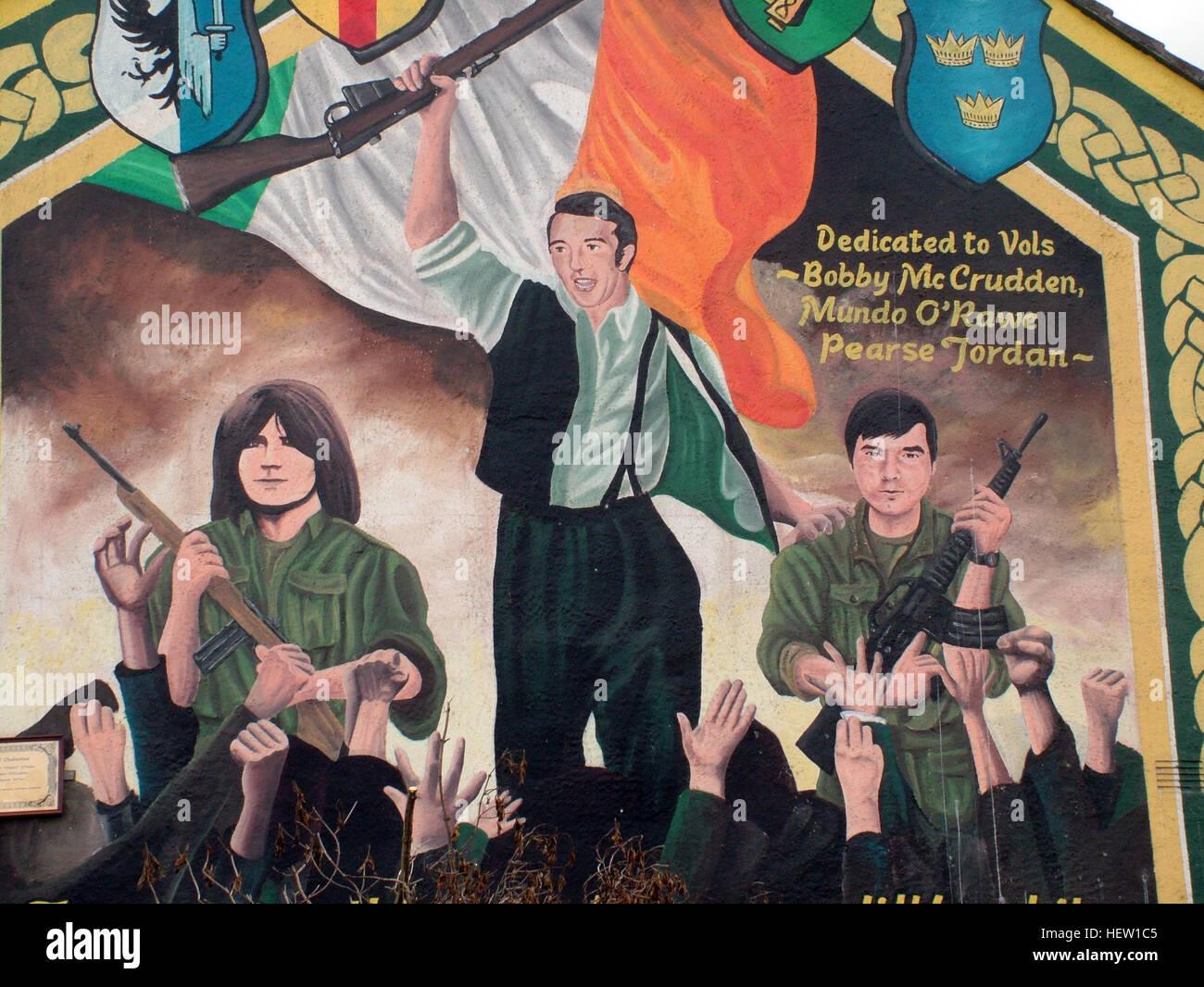 Road,painting,graffiti,resistance,IRA,peace,Northern Ireland,NI,UK,St,street,Eire,Irish,Republic,Irish Republic,conflict,Irish Republican Army,Political Change,Council House,Gable end,gable,end,Dedicated,to,Bobby McCrudden,Mundo O-Rawe,Pearse Jordan,Mundo ORawe,flag,rifle,gun,guns,GoTonySmith,@HotpixUK,Tony,Smith,UK,GB,Great,Britain,United,Kingdom,Irish,British,Ireland,problem,with,problem with,issue with,NI,Northern,Northern Ireland,Belfast,City,Centre,Art,Artists,the,troubles,The Troubles,Good Friday Agreement,Peace,honour,painting,wall,walls,tribute,republicanism,Fight,Justice,West,Beal,feirste,martyrs,social,tour,tourism,tourists,urban,six,counties,6,backdrop,county,Antrim,occupation,good,Friday,agreement,peace,reconciliation,IRA,terror,terrorists,genocide,Irish volunteers,Irish,volunteers,Belfast streets,murder,catholic,community,catholics,Buy Pictures of,Buy Images Of,Images of,Stock Images,Tony Smith,United Kingdom,Great Britain,British Isles,republican cause,Belfast Catholic Community