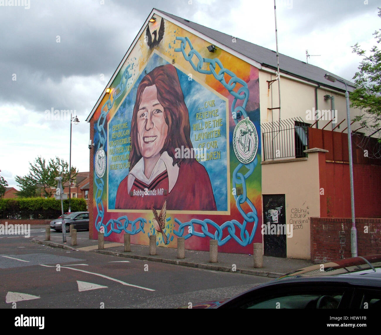 Road,painting,graffiti,resistance,IRA,peace,Northern Ireland,NI,UK,St,street,Eire,Irish,Republic,Irish Republic,conflict,Irish Republican Army,Political Change,Hblock,H-Block,Bobby Sands MP,Bobby Sands,hero,heroes,GoTonySmith,@HotpixUK,Tony,Smith,UK,GB,Great,Britain,United,Kingdom,Irish,British,Ireland,problem,with,problem with,issue with,NI,Northern,Northern Ireland,Belfast,City,Centre,Art,Artists,the,troubles,The Troubles,Good Friday Agreement,Peace,honour,painting,wall,walls,tribute,republicanism,Fight,Justice,West,Beal,feirste,martyrs,social,tour,tourism,tourists,urban,six,counties,6,backdrop,county,Antrim,occupation,good,Friday,agreement,peace,reconciliation,IRA,terror,terrorists,genocide,Buy Pictures of,Buy Images Of,Images of,Stock Images,Tony Smith,United Kingdom,Great Britain,British Isles,republican cause