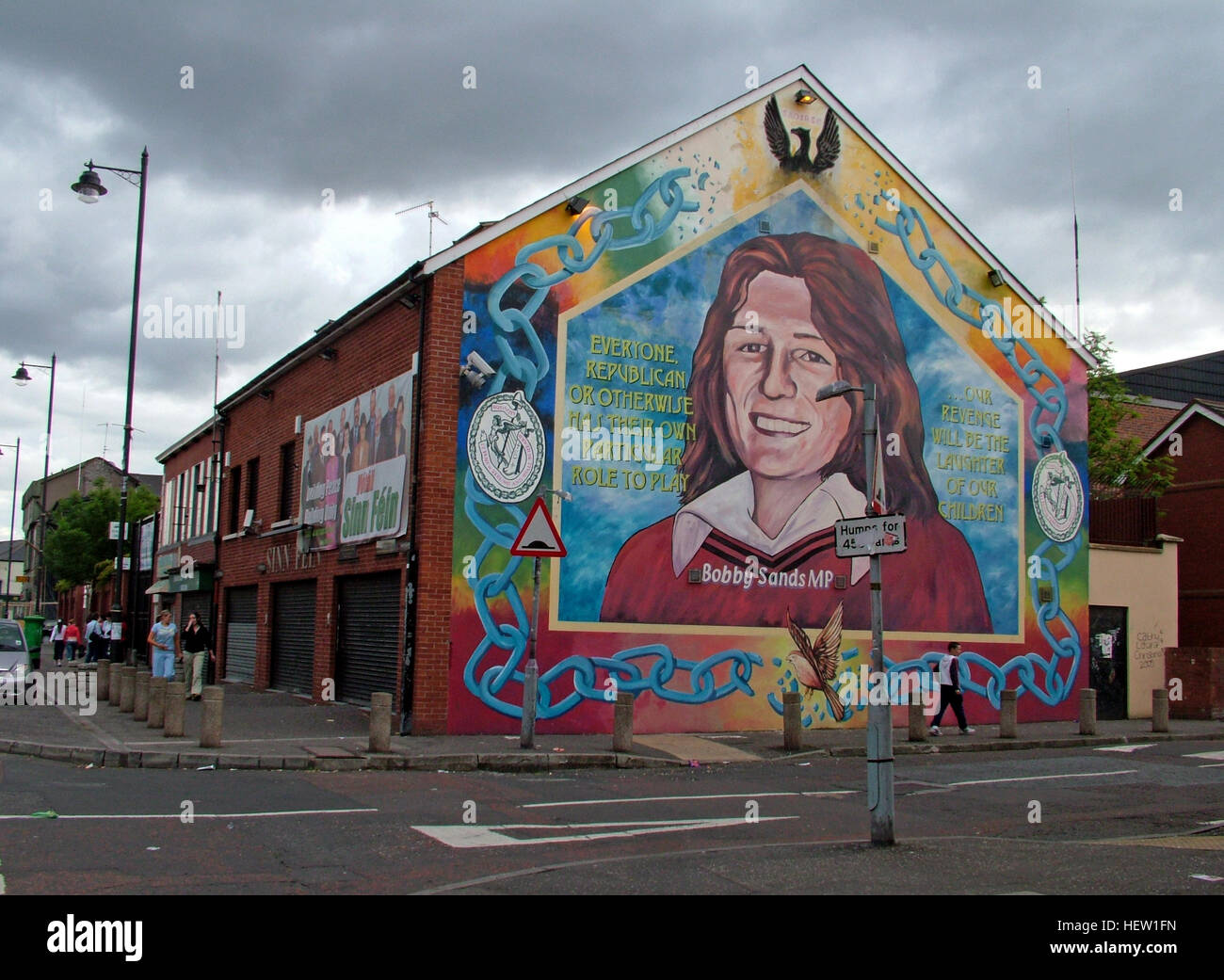 Road,painting,graffiti,resistance,IRA,peace,Northern Ireland,NI,UK,St,street,Eire,Irish,Republic,Irish Republic,conflict,Irish Republican Army,Political Change,Bobby,Sands,MP,IRA,Sinn Fein,Office,dark skies,dark sky,over West Belfast,Hblock,H-Block,GoTonySmith,@HotpixUK,Tony,Smith,UK,GB,Great,Britain,United,Kingdom,Irish,British,Ireland,problem,with,problem with,issue with,NI,Northern,Northern Ireland,Belfast,City,Centre,Art,Artists,the,troubles,The Troubles,Good Friday Agreement,Peace,honour,painting,wall,walls,tribute,republicanism,Fight,Justice,West,Beal,feirste,martyrs,social,tour,tourism,tourists,urban,six,counties,6,backdrop,county,Antrim,occupation,good,Friday,agreement,peace,reconciliation,IRA,terror,terrorists,genocide,catholic,community,catholics,Buy Pictures of,Buy Images Of,Images of,Stock Images,Tony Smith,United Kingdom,Great Britain,British Isles,republican cause,Belfast Catholic Community
