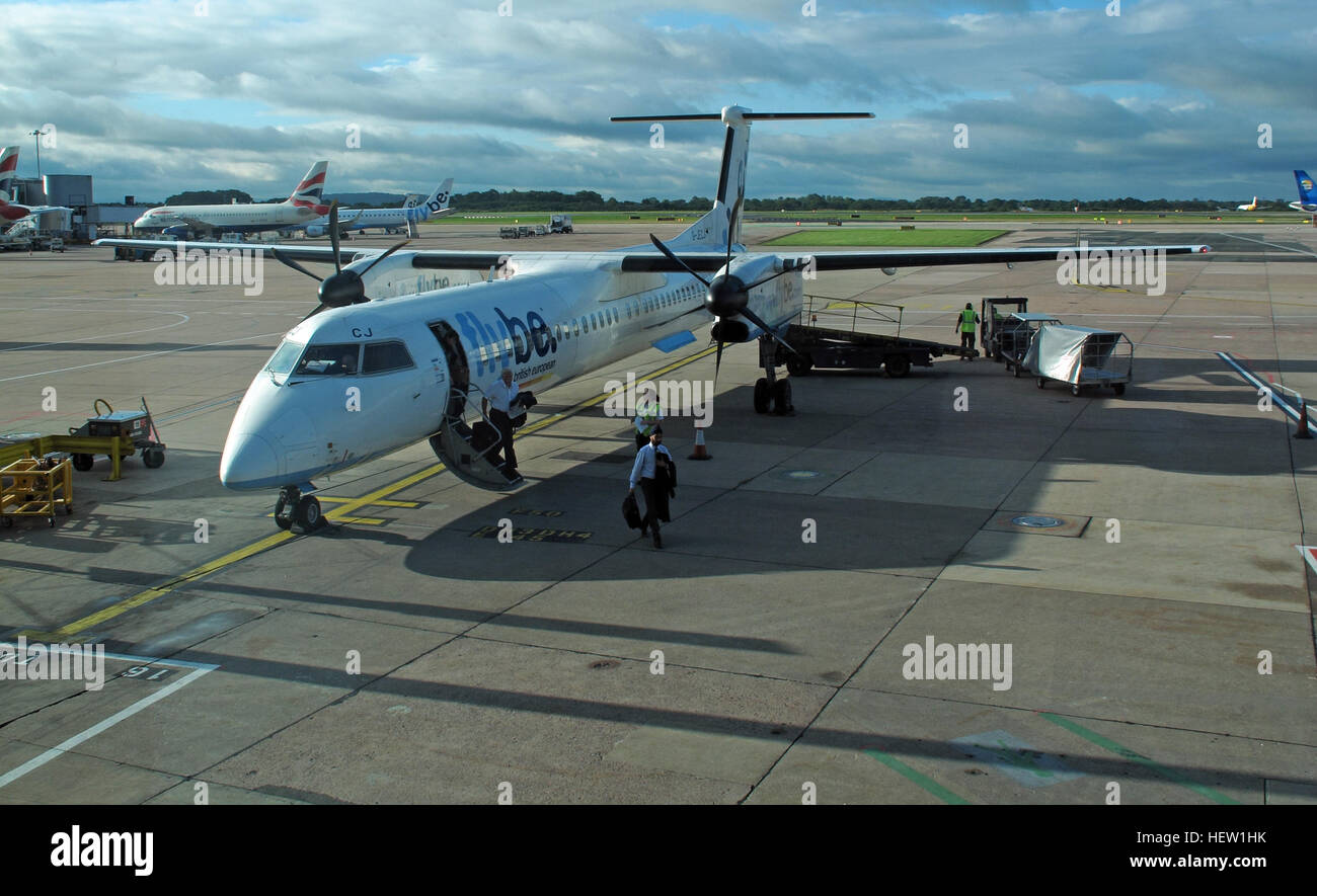 International,Manchester,gate,107,domestic,flight,afternoon,fly,Be,airport,airplane,propeller,G-JECJ,Q400,Q-400,disembarking,disembark,runway,a,airline,passengers,customers,leaving,step,steps,service,Manchester International,Gate 107,British European,GoTonySmith,@HotpixUK,Tony,Smith,UK,GB,Great,Britain,United,Kingdom,English,British,England,with,problem with,issue with,Manchester,transport,integrated infrastructure,travel,transit,infrastructure,airport,apron,jet,fuel,arrive,flight,flights,flyers,customer,cloud,cloudy,skies,clear,walk,walking,walkers,Domestic,Terminal,1st,first,Buy Pictures of,Buy Images Of,Images of,Stock Images,Tony Smith,United Kingdom,Great Britain,British Isles,Domestic Terminal,1st Passenger,to leave,Walker Aviation Limited