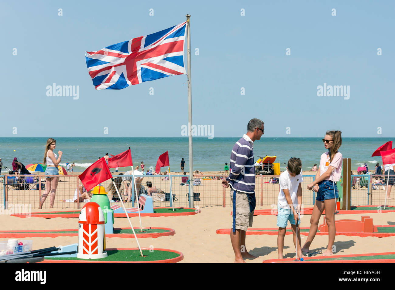 Family playing crazy golf on Margate Beach, Margate, Kent, England, United Kingdom - Stock Image
