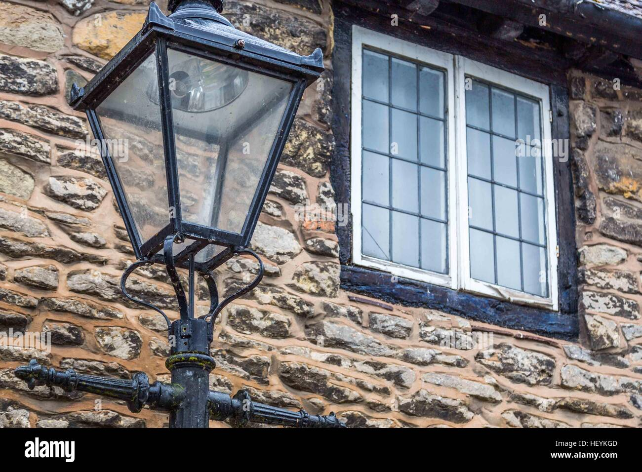an old fashioned street light outside a lovely cottage in Ross on Wye, Hereford Stock Photo