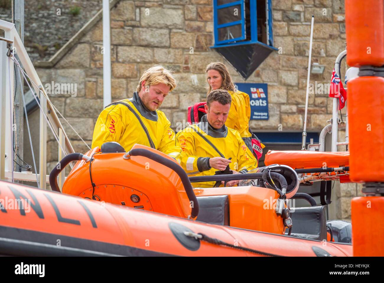 The RNLI in action in a rescue at Newquay Harbour in 2015 Stock Photo
