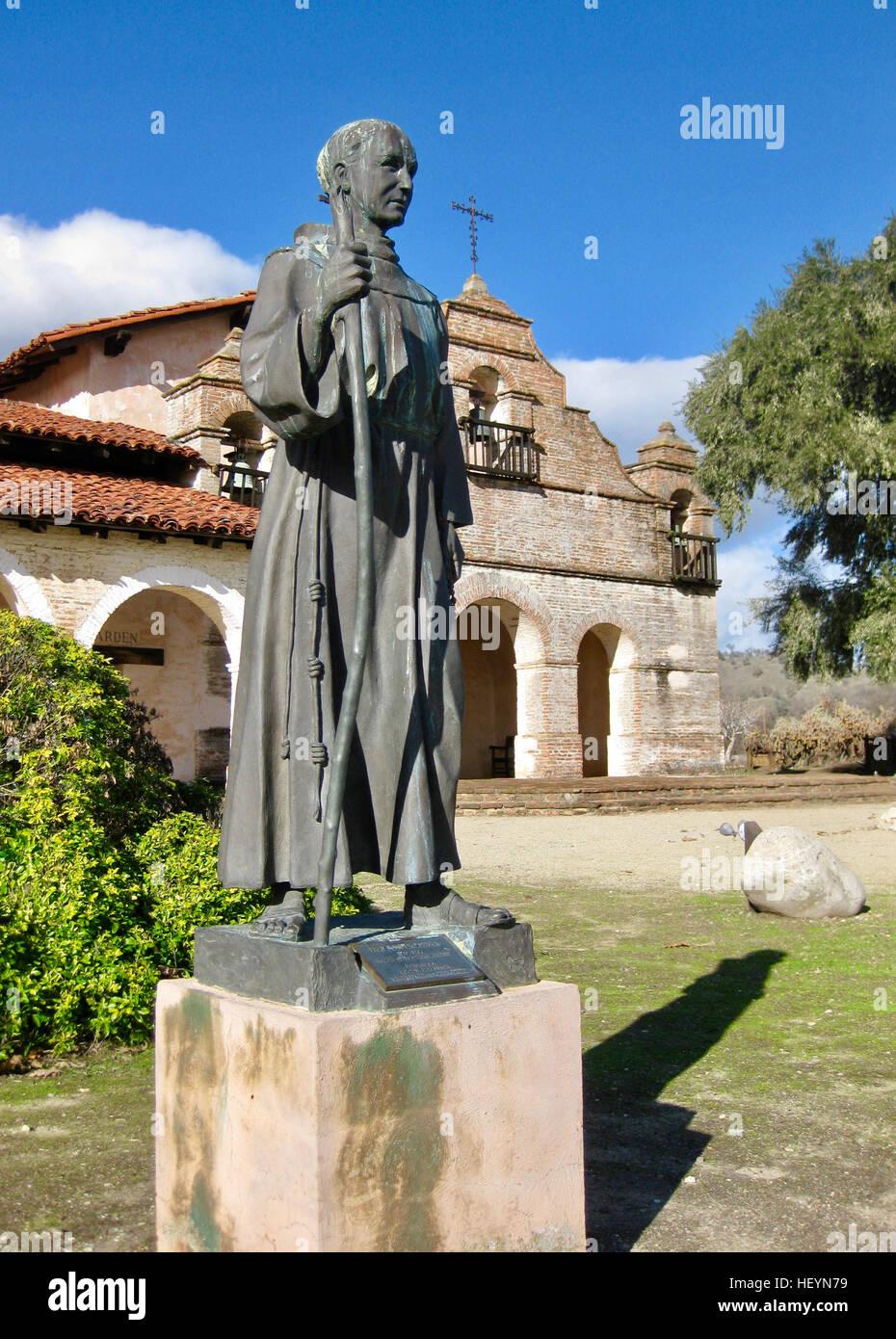 Father Junipero Serra statue in front of Mission San Antonio Stock Photo