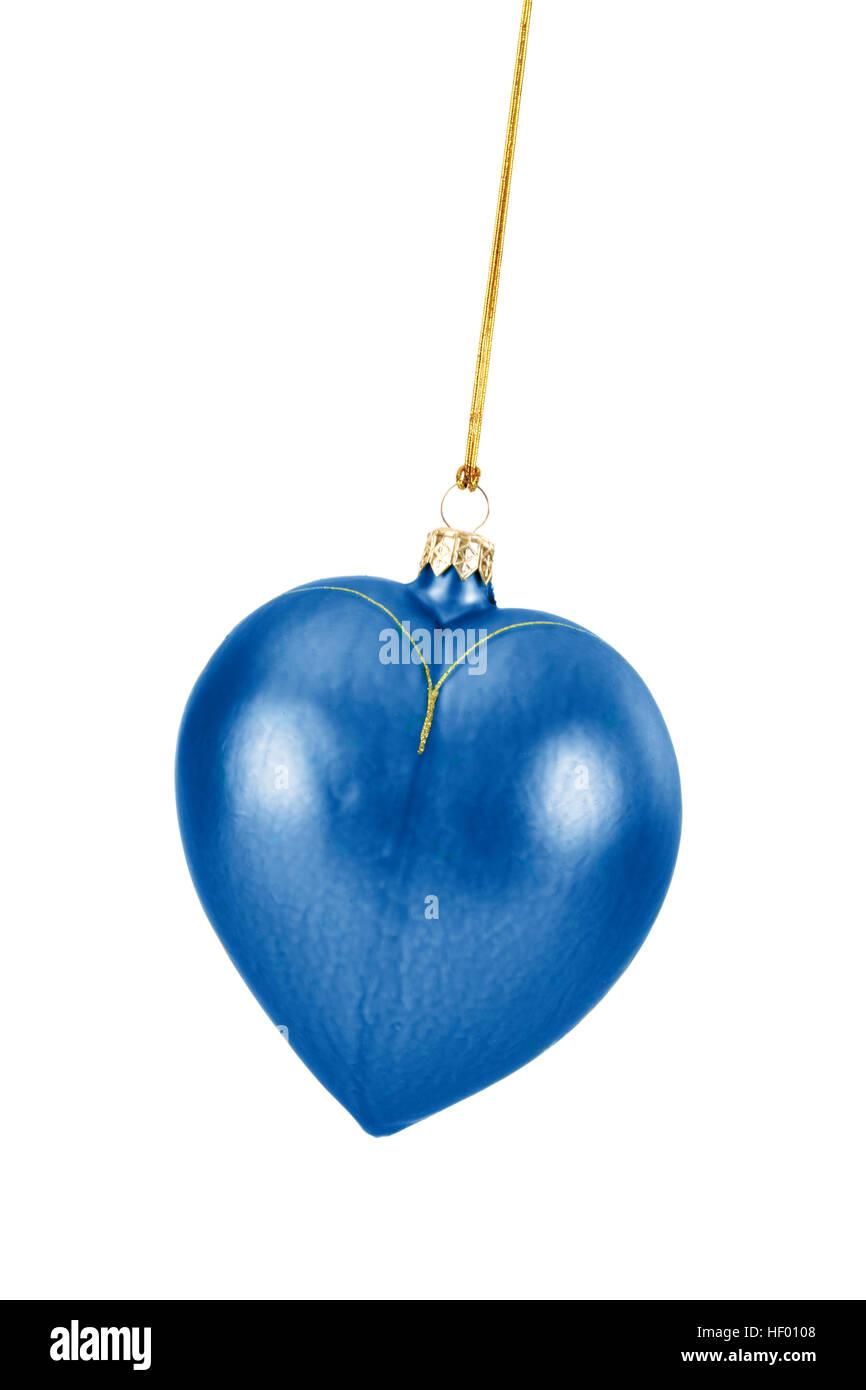 blue heart shaped christmas ornament on golden thread stock photo