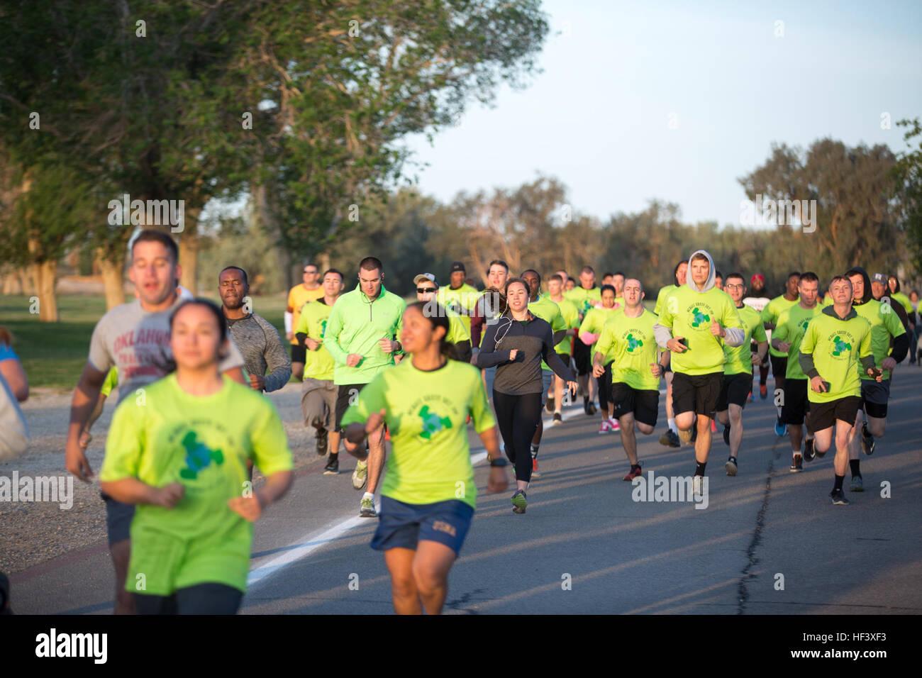 Combat Center patrons run through the Desert Winds Golf Course during the annual Earth Day 5K Fun Run April 15, - Stock Image