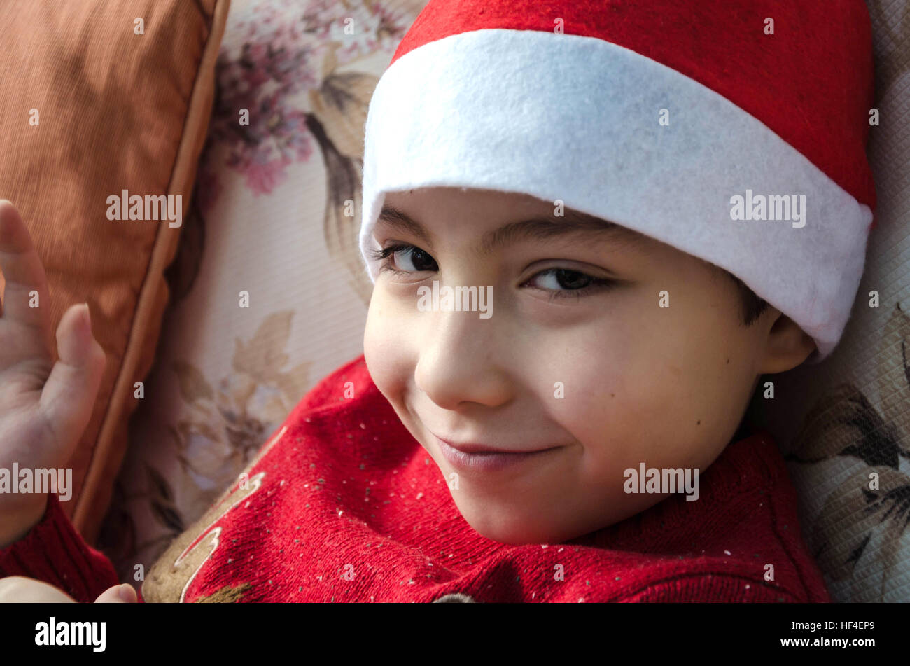 a-portrait-of-a-young-boy-wearing-a-father-christmas-hat-HF4EP9.jpg