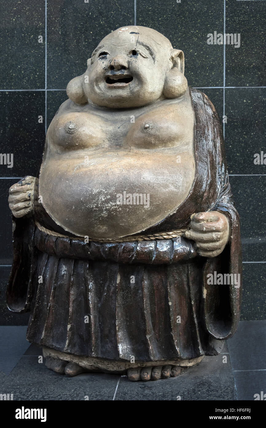 Fat jolly Buddha statue, Matsubara Dori, near Kiyomizu-dera Buddhist  temple, Kyoto, Japan - Stock Image