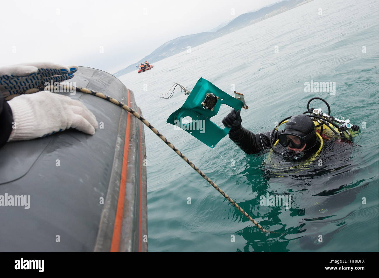 SOCHI, RUSSIA - DECEMBER 28, 2016: A diver during a search and rescue operation at the crash site of a Russian Defence Stock Photo