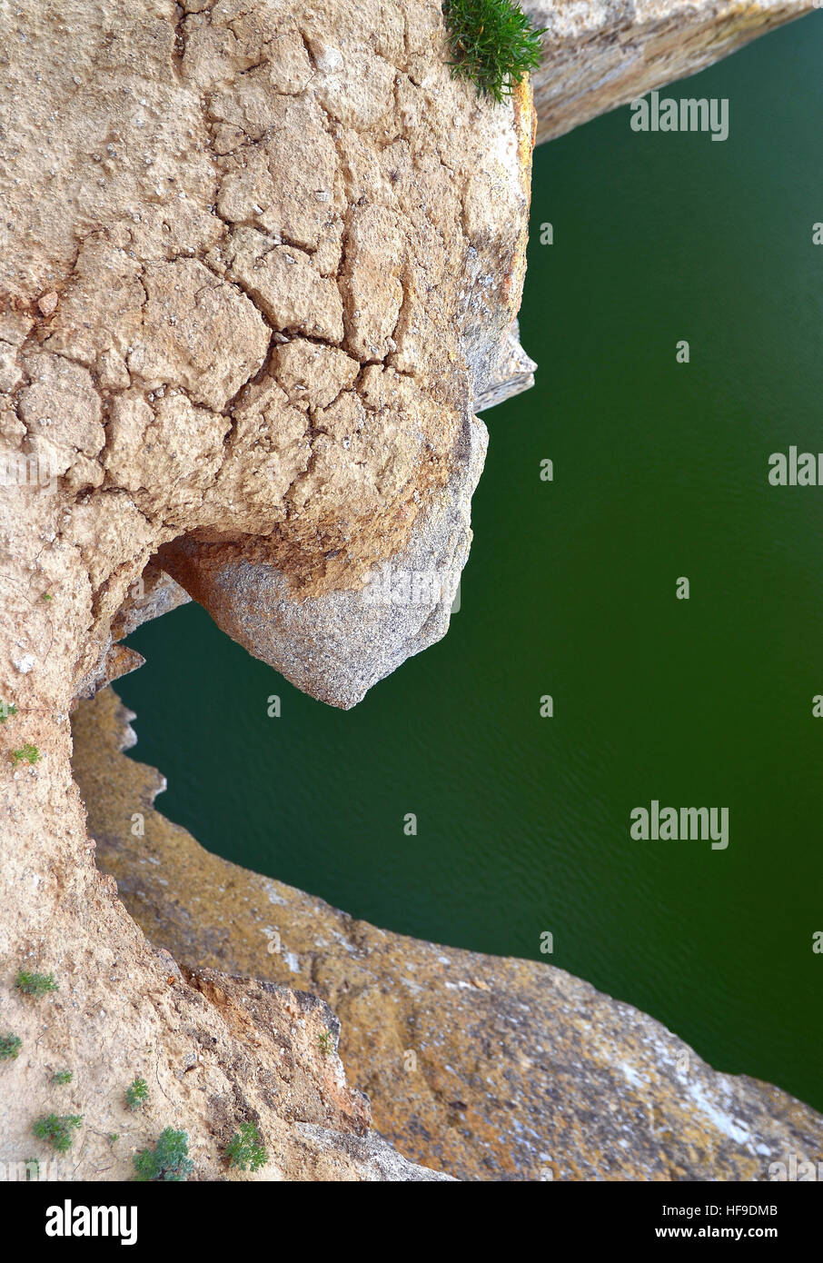 a stone jag seen from above one cliff of a lake seems like creating the image of a giant  dorment dragon - Stock Image