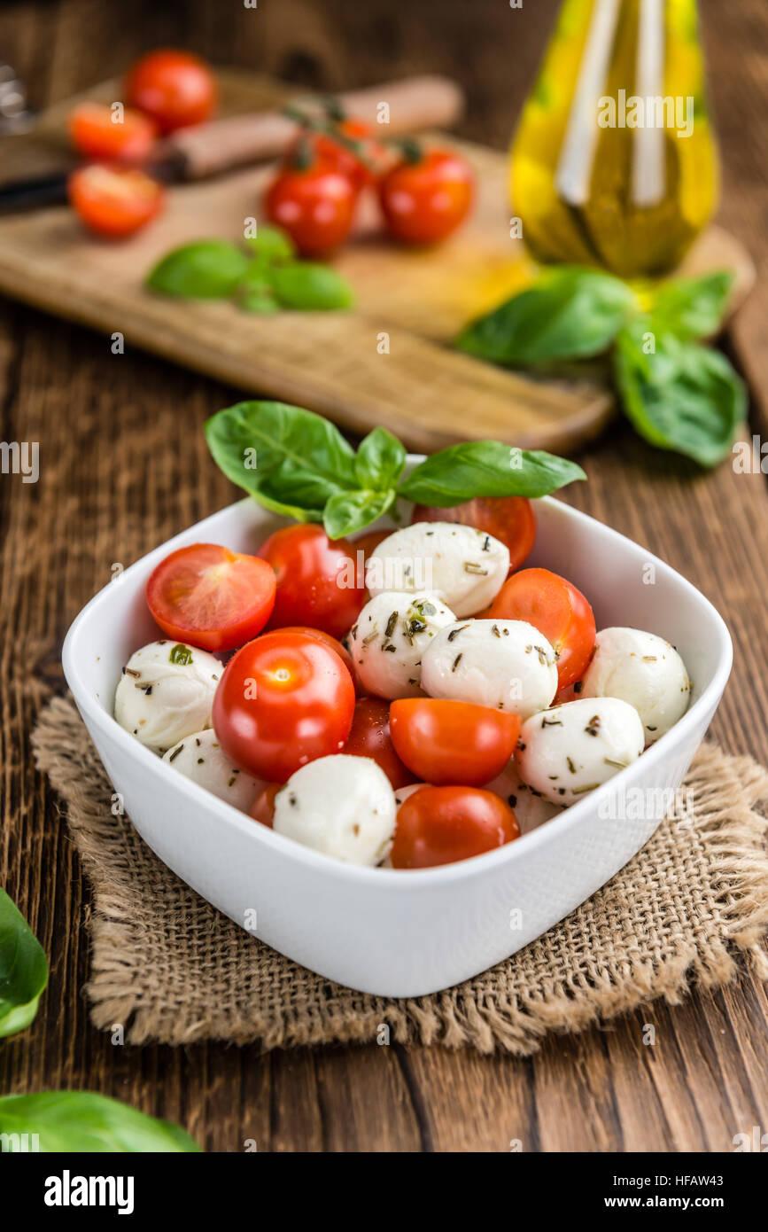 Fresh made Tomato Mozzarella Salad with Basil (selective focus) - Stock Image